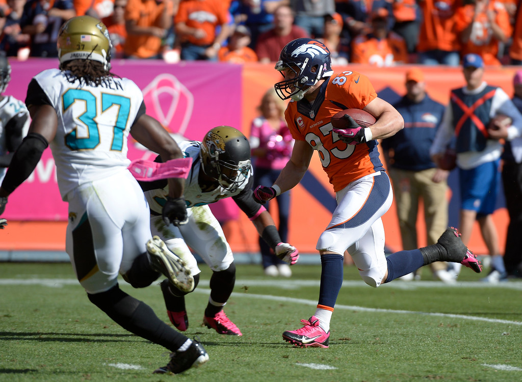 . Denver Broncos wide receiver Wes Welker (83) makes a run to the end zone for a touchdown in the first quarter.   (Photo by John Leyba/The Denver Post)
