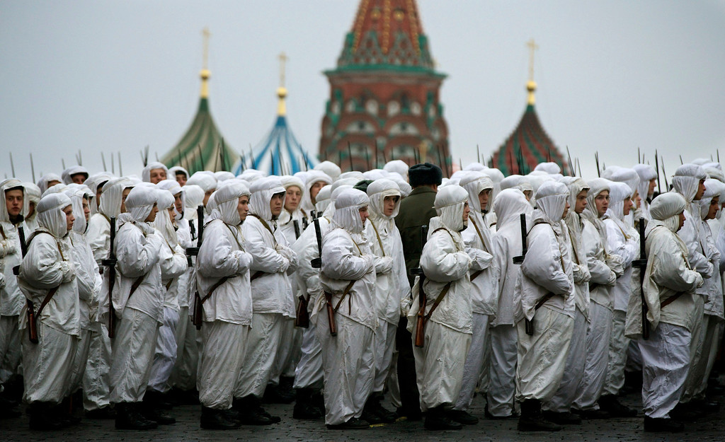 . Russian soldiers wear snow gear over Red Army World War II uniforms as they prepare to parade in Red Square in front of St. Basil Cathedral in Moscow, Russia, Thursday, Nov. 7, 2013. Thousands of Russian soldiers and military cadets marched across Red Square to mark the 72nd anniversary of a historic World War II parade. The show honored the participants of the Nov. 7, 1941 parade who headed directly to the front lines to defend Moscow from the Nazi forces. The parade Thursday involved about 6,000 people, many of them dressed in World War II-era uniforms. (AP Photo/Alexander Zemlianichenko)