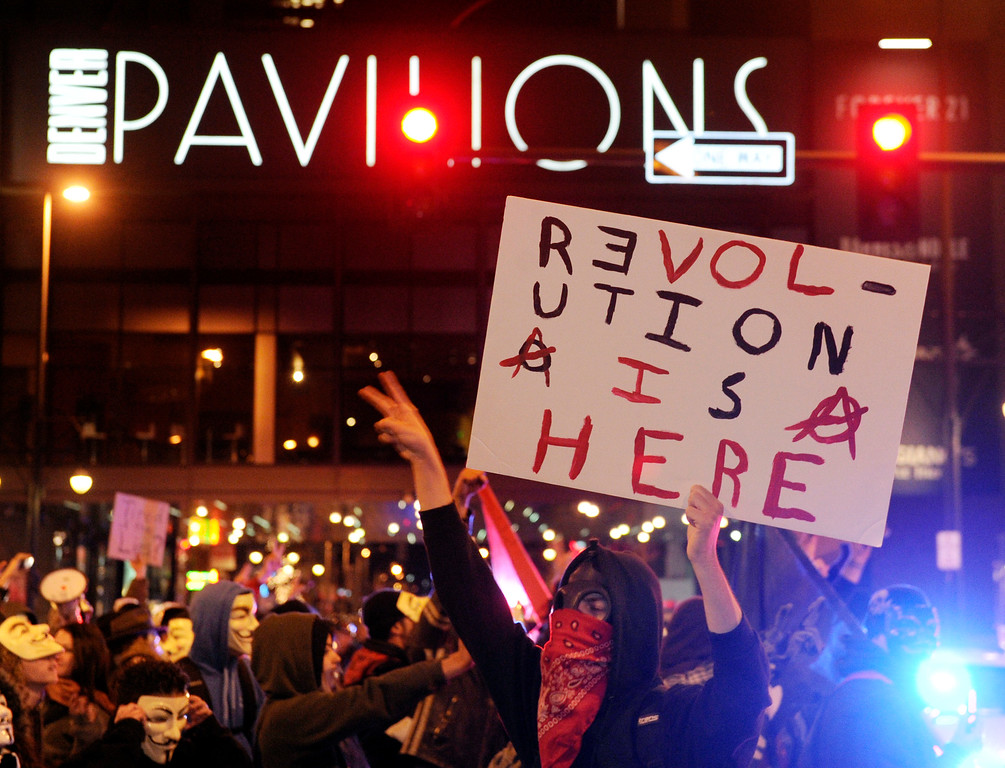 . DENVER, CO. - NOVEMBER 5: Two hundred protesters calling themselves Anonymous tied up traffic in downtown Denver Tuesday night, November 5, 2013.  The event was called the Million Mask March, and many protesters wore Guy Fawkes masks to hid their identity. Photo By Karl Gehring/The Denver Post