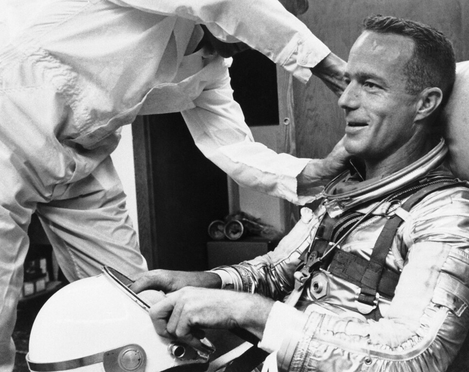 . Astronaut Scott Carpenter gets a final going over from a suit technician as he prepares for orbital flight at Cape Canaveral, Florida, May 24, 1962. (AP Photo)