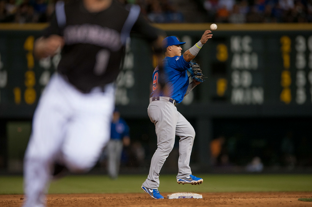 . DENVER, CO - AUGUST 06:  Javier Baez #9 of the Chicago Cubs steps on second base bag for a force out  and turns a double play with a putout at first as a Rockies baserunner reaches third base in the sixth inning of a game at Coors Field on August 6, 2014 in Denver, Colorado.  (Photo by Dustin Bradford/Getty Images)