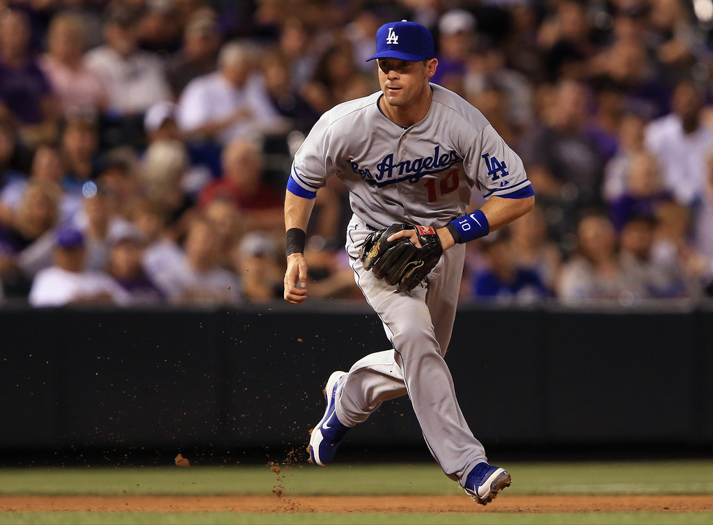. Third baseman Michael Young #10 of the Los Angeles Dodgers fields a ground ball by Wilin Rosario #20 of the Colorado Rockies and throws him out to end the fourth inning at Coors Field on September 3, 2013 in Denver, Colorado.  (Photo by Doug Pensinger/Getty Images)