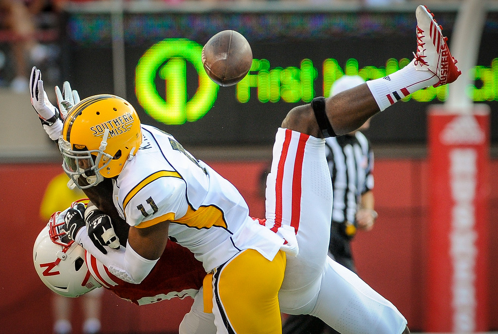 . LINCOLN, NE - SEPTEMBER 7: Wide receiver Quincy Enunwa #18 of the Nebraska Cornhuskers fights for a ball with defensive back Kalan Reed #11 of the Southern Miss Golden Eagles during their game at Memorial Stadium on September 7, 2013 in Lincoln, Nebraska. (Photo by Eric Francis/Getty Images)