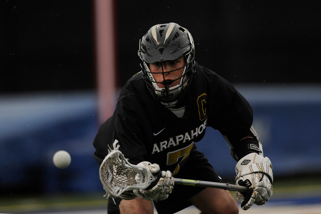 . DENVER, CO - MAY 15: Arapahoe senior attacker Tyler Widlund #7 eyes the ball against Regis Jesuit during a CHSAA 5A boys lacrosse semifinal game on May 15, 2013, in Denver, Colorado. Arapahoe won 13-5 to advance to the finals. (Photo by Daniel Petty/The Denver Post)