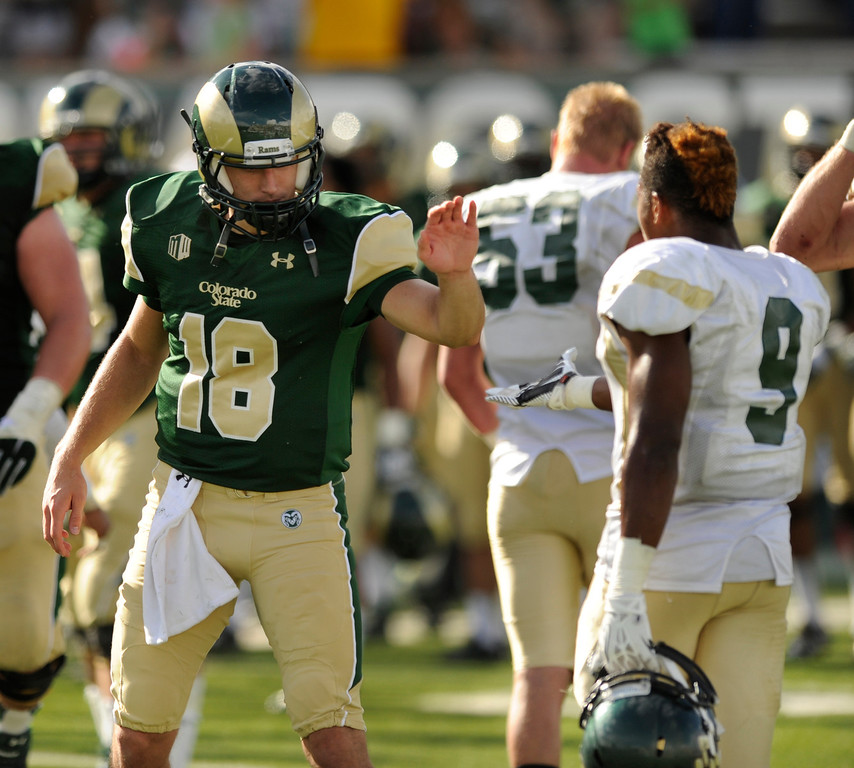 . FORT COLLINS, CO. - SEPTEMBER 14: CSU quarterback Garrett Grayson (18) exchanged greetings with Cal Poly signal caller Chris Brown (9) at the end of the game. The Colorado State University football team defeated Cal Poly at Hughes Stadium in Fort Collins Saturday afternoon, September 14, 2013.  It was the Rams\' first home game and first win of the season. Photo By Karl Gehring/The Denver Post