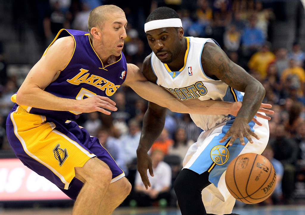 . DENVER, CO - NOVEMBER 13: Los Angeles Lakers point guard Steve Blake (5) reaches in on Denver Nuggets point guard Ty Lawson (3) during the first quarter November 13, 2013 at Pepsi Center. (Photo by John Leyba/The Denver Post)