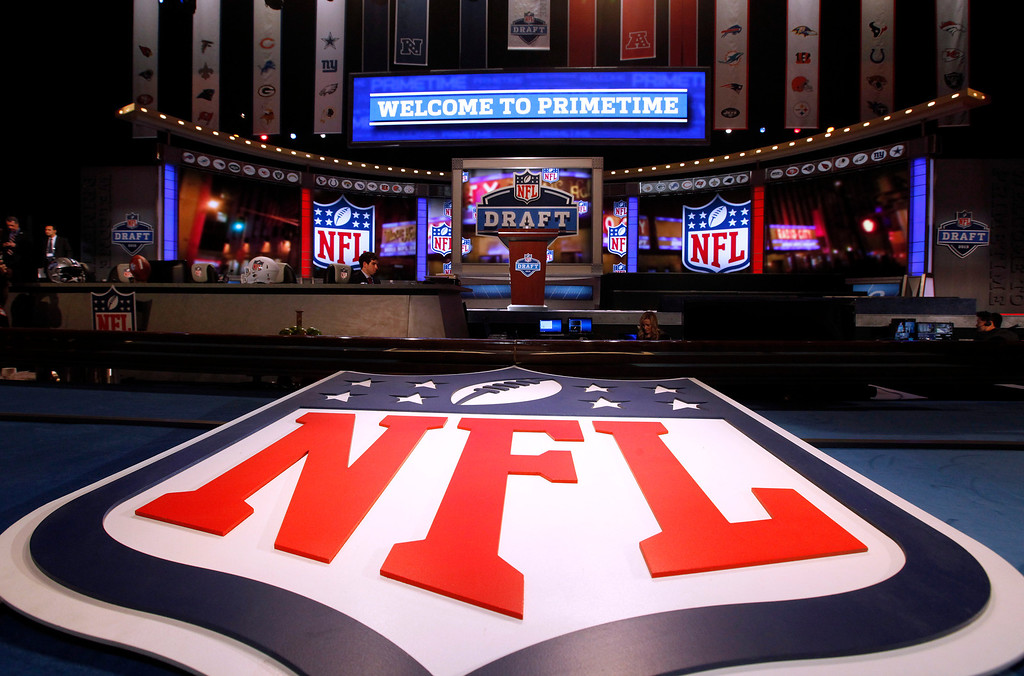 . A large NFL logo decorates the stage before the first round of the NFL football draft at Radio City Music Hall, Thursday, April 25, 2013, in New York. (AP Photo/Jason DeCrow)