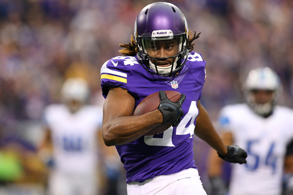 . Cordarrelle Patterson #84 of the Minnesota Vikings carries the ball 50 yards for a touchdown against the Detroit Lions on December 29, 2013 at Mall of America Field at the Hubert H. Humphrey Metrodome in Minneapolis, Minnesota. (Photo by Adam Bettcher/Getty Images)