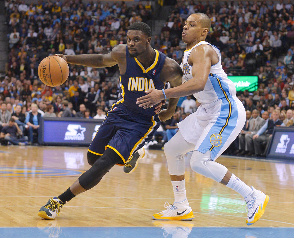 . Indiana Pacers shooting guard Lance Stephenson (1) drives around Denver Nuggets shooting guard Randy Foye (4) during the third quarter of an NBA basketball game Saturday, Jan. 25, 2014, in Denver. (AP Photo/Jack Dempsey)