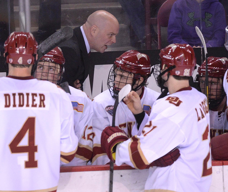 . DENVER, CO. - JANUARY 24:  Denver coach Jim Montgomery had words for the team in the second period. The University of Denver hockey team hosted North Dakota at Magness Arena Friday night, January 24, 2014. Photo By Karl Gehring/The Denver Post