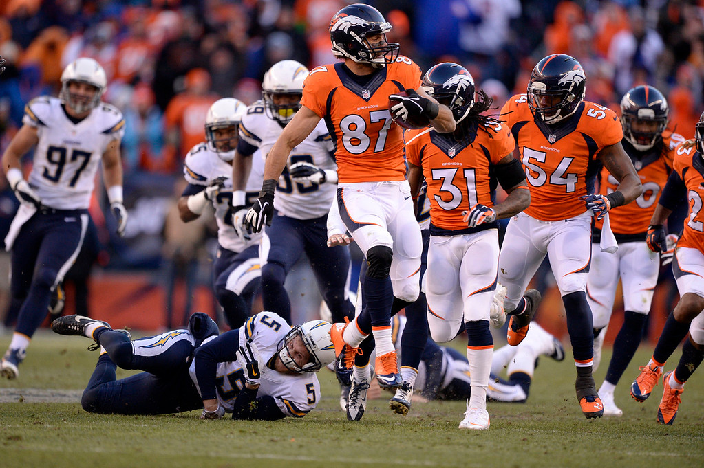 . Denver Broncos wide receiver Eric Decker (87) leaping during a punt return /in the second quarter. The Denver Broncos vs. The San Diego Chargers in an AFC Divisional Playoff game at Sports Authority Field at Mile High in Denver on January 12, 2014. (Photo by John Leyba/The Denver Post)