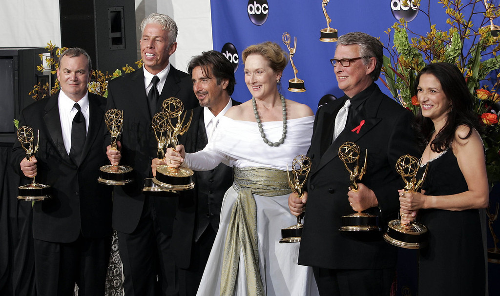 ". Cast and producers including Al Pacino, third from left, Meryl Streep, third from right, and Mike Nichols, second from right, hold the award for outstanding miniseries for their work on ""Angels In America,\"" at the 56th Annual Primetime Emmy Awards Sunday, Sept. 19, 2004, at the Shrine Auditorium in Los Angeles.   (AP Photo/Mark J. Terrill)"