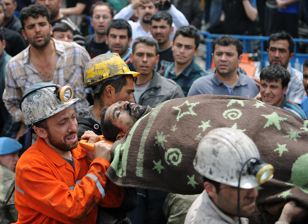 . Rescue workers carry the body of a miner outside the coal mine in Soma, Turkey, Wednesday, May 14, 2014.   (AP Photo/Depo Photos)