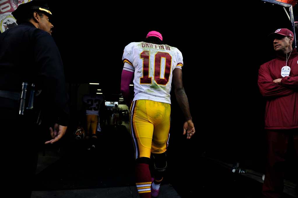 . Washington Redskins quarterback Robert Griffin III (10) leaves the field. The Denver Broncos take on the Washington Redskins at Sports Authority Field at Mile High in Denver on October 27, 2013. (Photo by AAron Ontiveroz/The Denver Post)