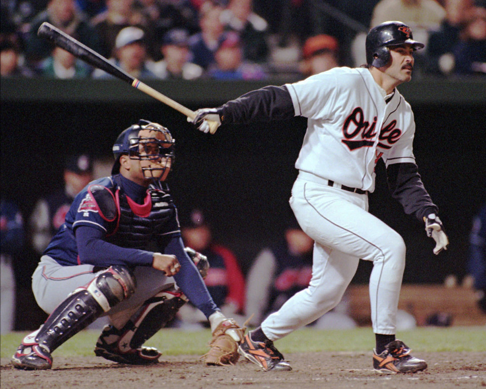 . RAFAEL PALMEIRO -- Baltimore Orioles Rafael Palmeiro strokes the game-winning hit in the 10th inning as Cleveland Indians catcher Sandy Alomar watches on April 10, 1996 at Camden Yards.  (AP Photo/Dave Hammond)
