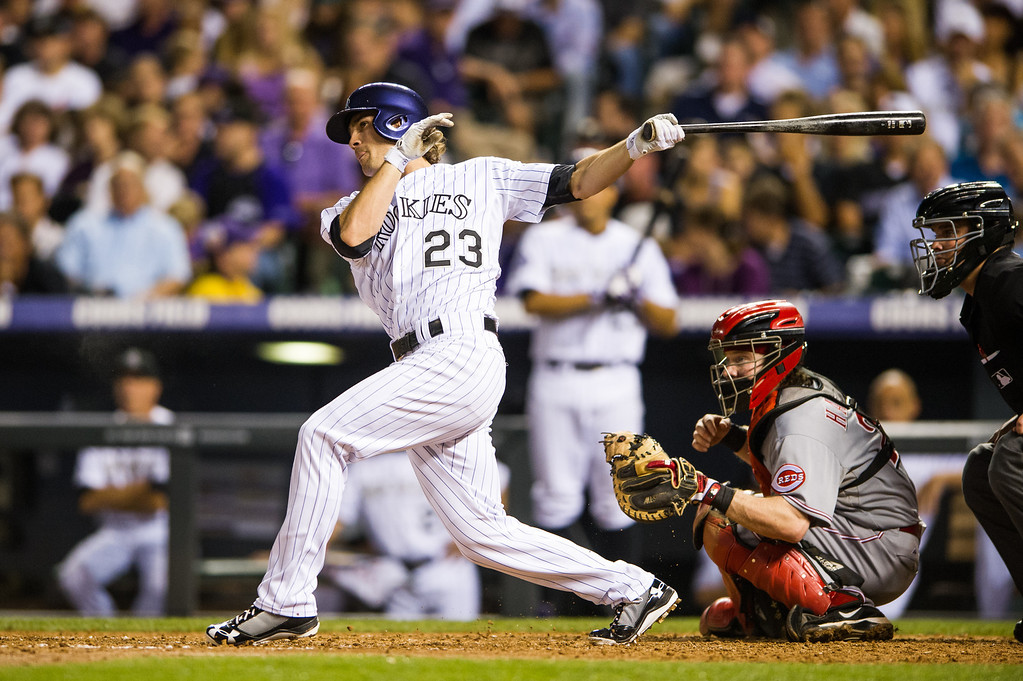 . DENVER, CO - AUGUST 30:  Charlie Culberson #23 of the Colorado Rockies hits a 2-RBI double in the fourth inning of a game against the Cincinnati Reds at Coors Field on August 30, 2013 in Denver, Colorado. (Photo by Dustin Bradford/Getty Images)