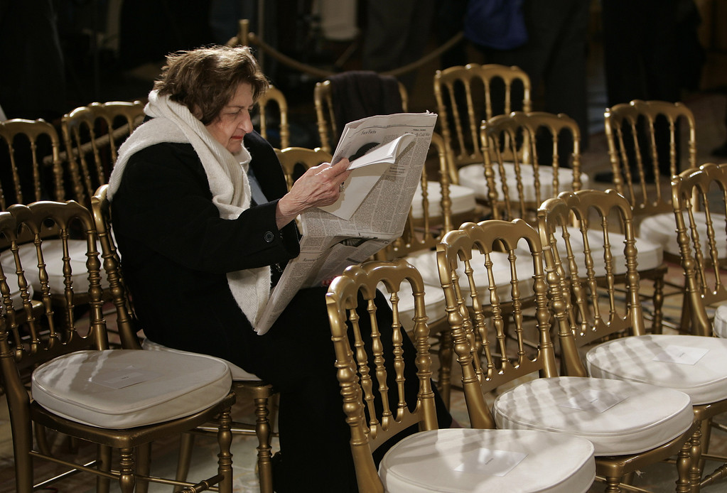. In this Oct, 25, 2006 file photo, Veteran White House reporter Helen Thomas arrives early and waits for a presidential event in the East Room of the White House. Thomas, a pioneer for women in journalism and an irrepressible White House correspondent, has died. She was 92. Thomas made her name as a bulldog for United Press International in the great wire-service rivalries of old. She used her seat in the front row of history to grill nine presidents _ often to their discomfort and was not shy about sharing her opinions.   (AP Photo/Ron Edmonds, File)