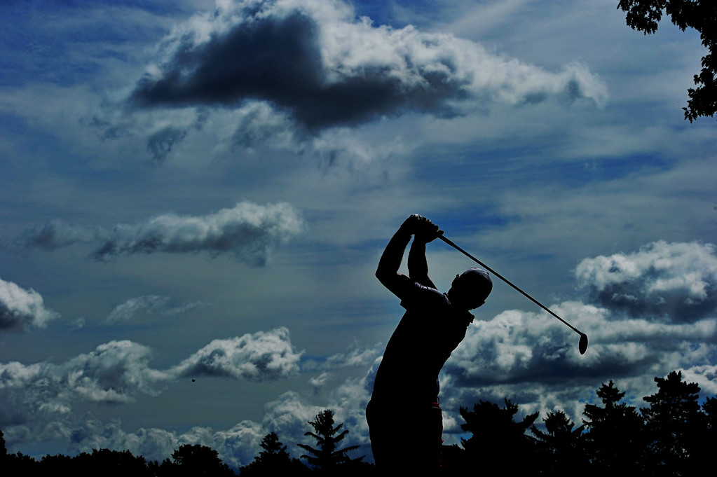 . ROCHESTER, NY - AUGUST 10:  Keegan Bradley of the United States watches his tee shot on the first hole during the third round of the 95th PGA Championship on August 10, 2013 in Rochester, New York.  (Photo by Stuart Franklin/Getty Images)