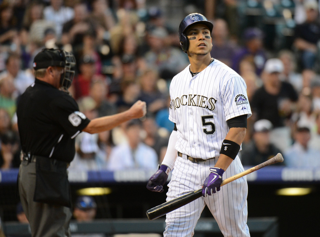 . Denver, CO. - June 08: Carlos Gonzalez of Colorado Rockies (5) strike out by Dale Thayer of San Diego Padres (55) in the 8th inning of the game at Coors Field. Denver, Colorado. June 8, 2013. San Diego won 4-2. (Photo By Hyoung Chang/The Denver Post)
