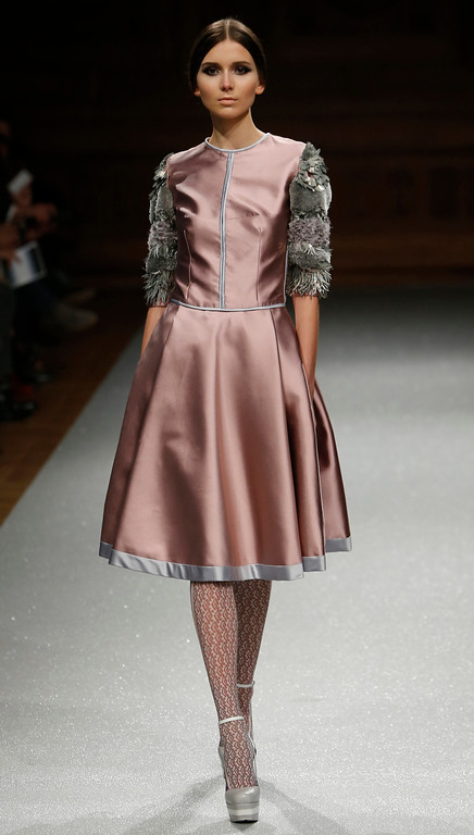 . A model wears a creation as part of the Oscar Carvallo Fall Winter 2014-15 Haute Couture fashion collection, presented in Paris, Thursday, July 10, 2014. (AP Photo/Jacques Brinon)