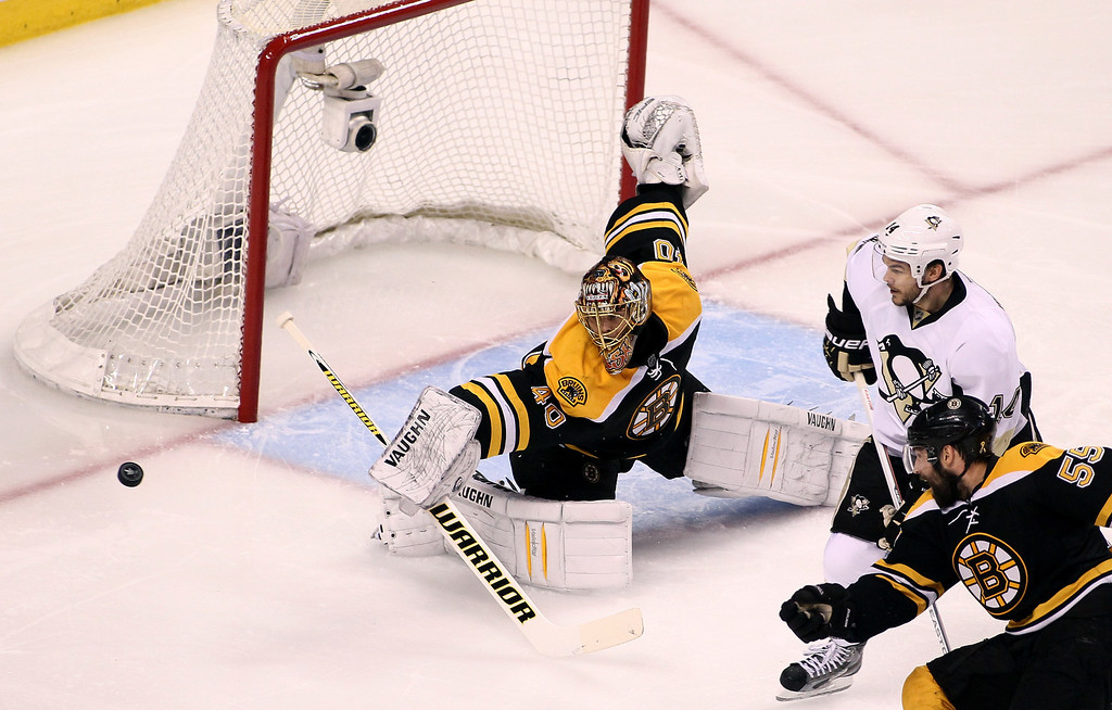. BOSTON, MA - JUNE 07: Tuukka Rask #40 of the Boston Bruins makes a save against Brooks Orpik #44 of the Pittsburgh Penguins in the first period in Game Four of the Eastern Conference Final during the 2013 Stanley Cup Playoffs at TD Garden on June 7, 2013 in Boston, Massachusetts.  (Photo by Alex Trautwig/Getty Images)