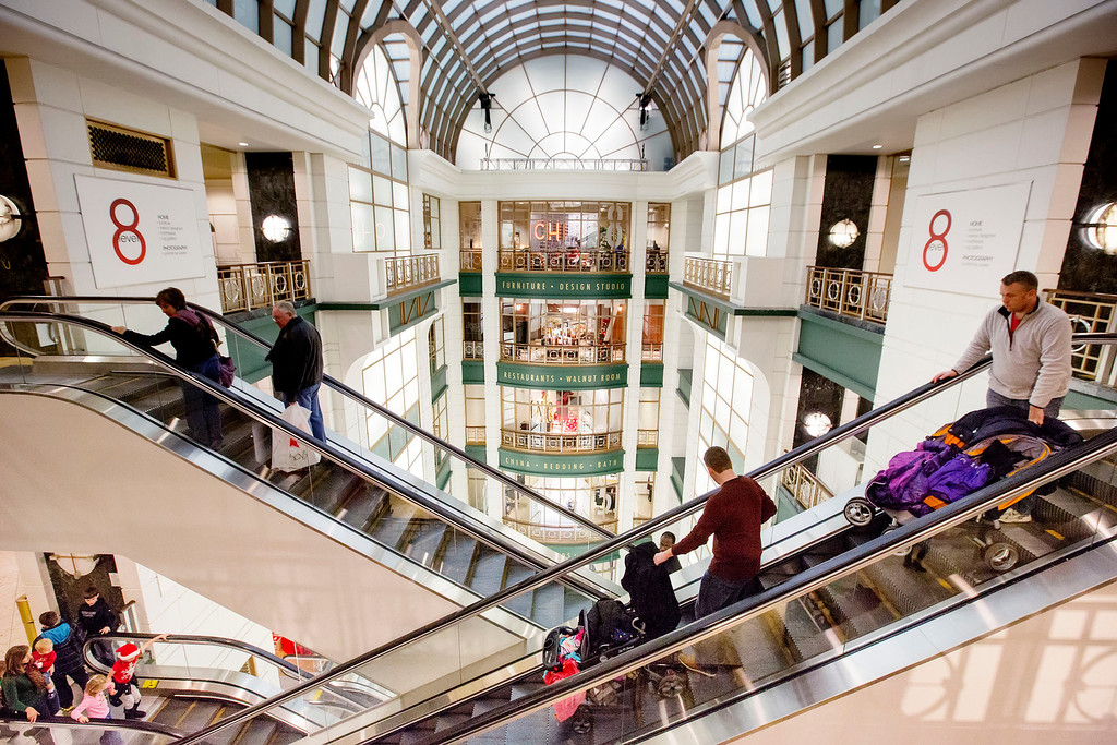 . Shoppers ride escalators between floors during Black Friday shopping at Macy\'s on Friday, Nov. 29, 2013, in Chicago. Black Friday, the day after Thanksgiving, is typically the nation\'s biggest shopping day of the year. (AP Photo/Andrew A. Nelles)