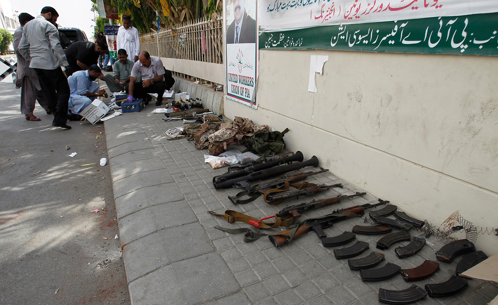 . Pakistani security forces examine ammunition confiscated from attackers who stormed late Sunday the Jinnah International Airport, during their investigation in Karachi, Pakistan, Monday, June 9, 2014.  (AP Photo/Fareed Khan)