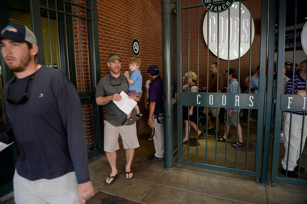 . DENVER, CO. - AUGUST 16:  Colorado Rockies fans head out of Coors Field Saturday evening, August 16, 2014 in advance of the announcement came that the game against the Cincinnati Reds was cancelled due to a water main break along Blake St, cutting off water supply to the stadium. (Photo By Andy Cross / The Denver Post)