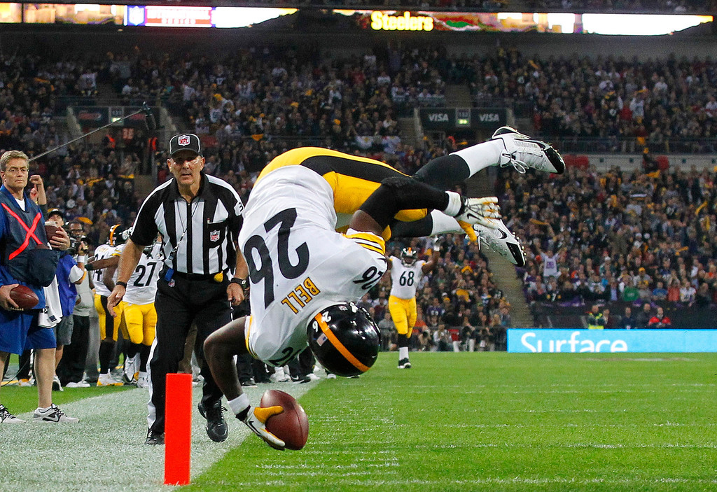 . Pittsburgh Steelers running back Le\'Veon Bell flips over as he scores a touchdown during the  NFL football game against Minnesota Vikings at Wembley Stadium, London, Sunday, Sept. 29, 2013.  (AP Photo/Sang Tan)