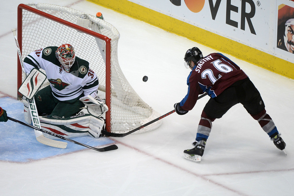 . Paul Stastny (26) of the Colorado Avalanche takes a shot on Ilya Bryzgalov (30) of the Minnesota Wild during the second period of action. The Colorado Avalanche hosted the Minnesota Wild in the first round of the NHL playoffs at the Pepsi Center on Thursday, April 17, 2014. (Photo by Karl Gehring/The Denver Post)