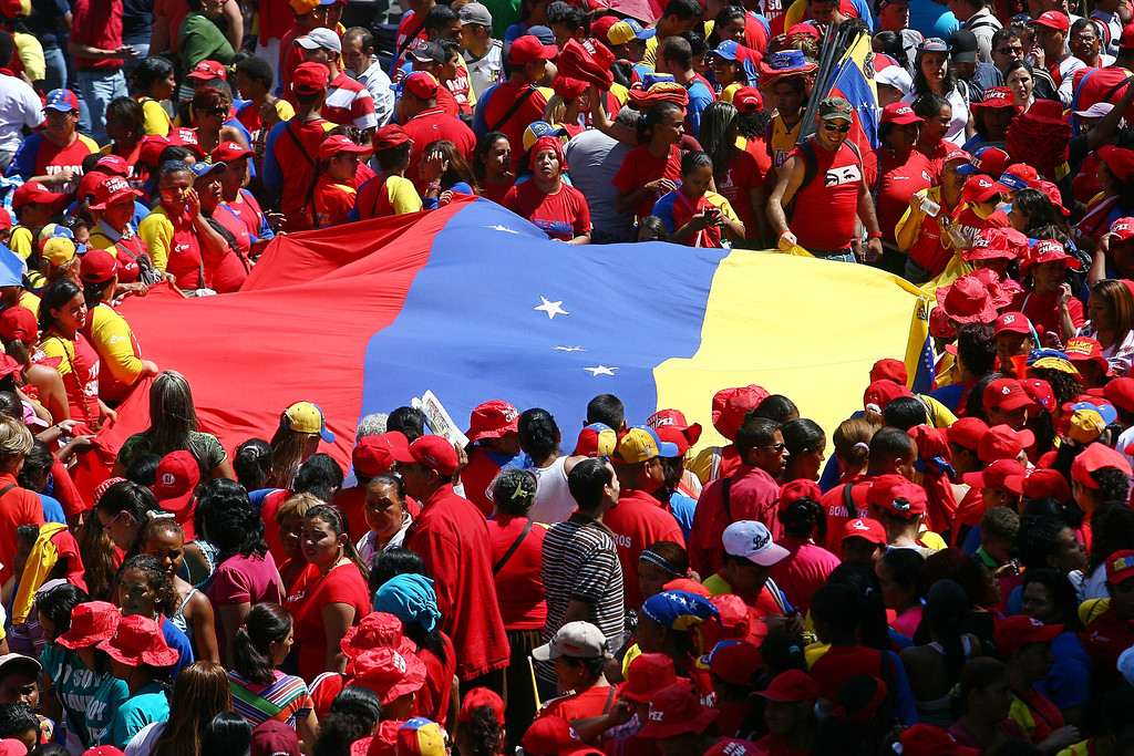 ". Supporters of Venezuelan President Hugo Chavez rally in Caracas on February 27, 2013, to commemorate the 24th anniversary of the Patriotic Rebellion. The ""Caracazo\"" of 1989 was a wave of protests against the neoliberal reforms imposed by the government of President Carlos Andres Perez, during which some 3000 people were killed. GERALDO CASO/AFP/Getty Images"