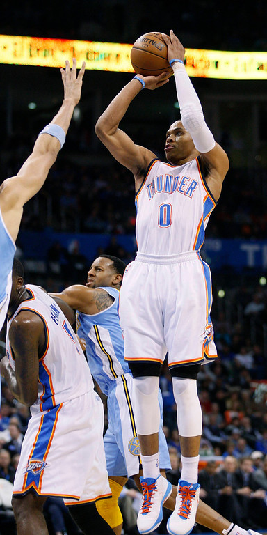 . Oklahoma City Thunder guard Russell Westbrook shoots against the Denver Nuggets in the second half of their NBA basketball game in Oklahoma City, Oklahoma January 16, 2013. REUTERS/Bill Waugh