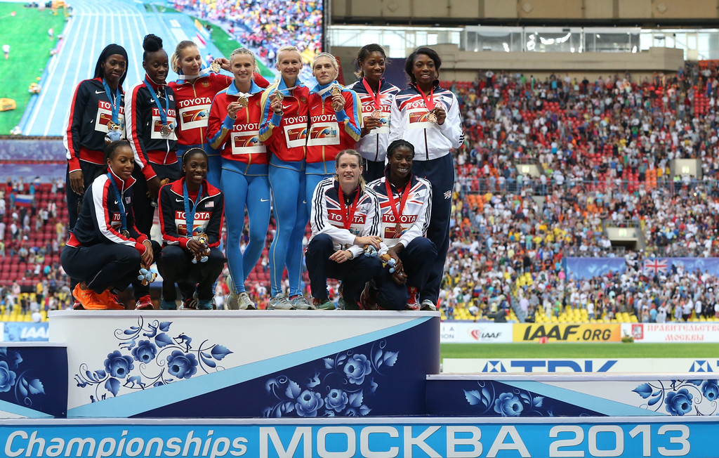 . The US, Russian and British relay teams pose on the podium during the medal ceremony for the women\'s 4x400 metres relay at the 2013 IAAF World Championships at the Luzhniki stadium in Moscow on August 17, 2013.  ALEXANDER NEMENOV/AFP/Getty Images