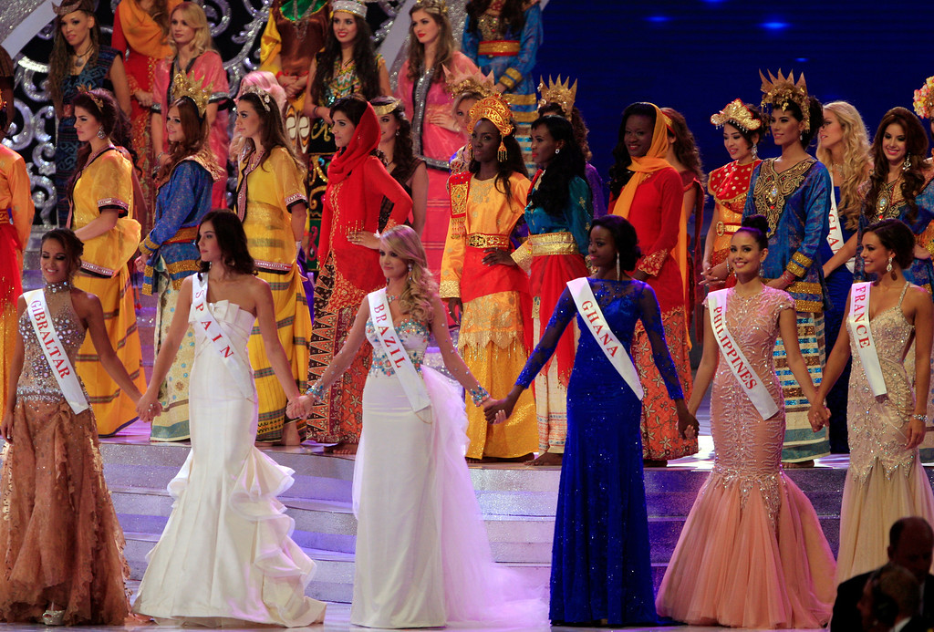 . Contestants front row from left, Miss Gibraltar Maroua Kharbouch, Miss Spain Elena Ibarbian Jimenez, Miss Brazil Sancler Frantz Konzen, Miss Ghana Carranza Naa Okailey Shooter, Miss Philippines Megan Young and Miss France Marine Lorpheline during the grand final of Miss World 2013 pageant in Nusa Dua, Bali, Indonesia, Saturday, Sept. 28, 2013. Young was crowned Miss World on Saturday amid tight security on Indonesia\'s resort island of Bali, where the contest\'s final round was moved following protests by Muslim hardliner groups. (AP Photo/Firdia Lisnawati)