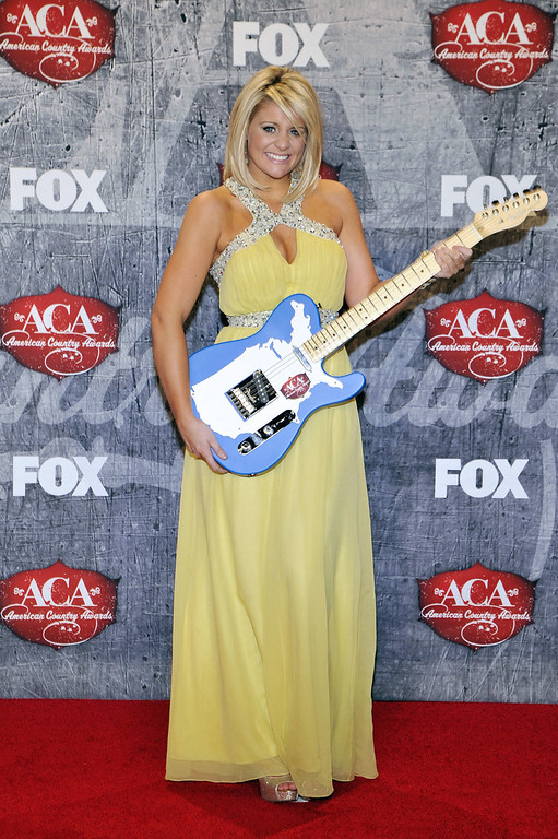 . Singer Lauren Alaina poses in the press room with her award for New Artist of the Year backstage at the American Country Awards on Monday, Dec. 10, 2012, in Las Vegas. (Photo by Jeff Bottari/Invision/AP)