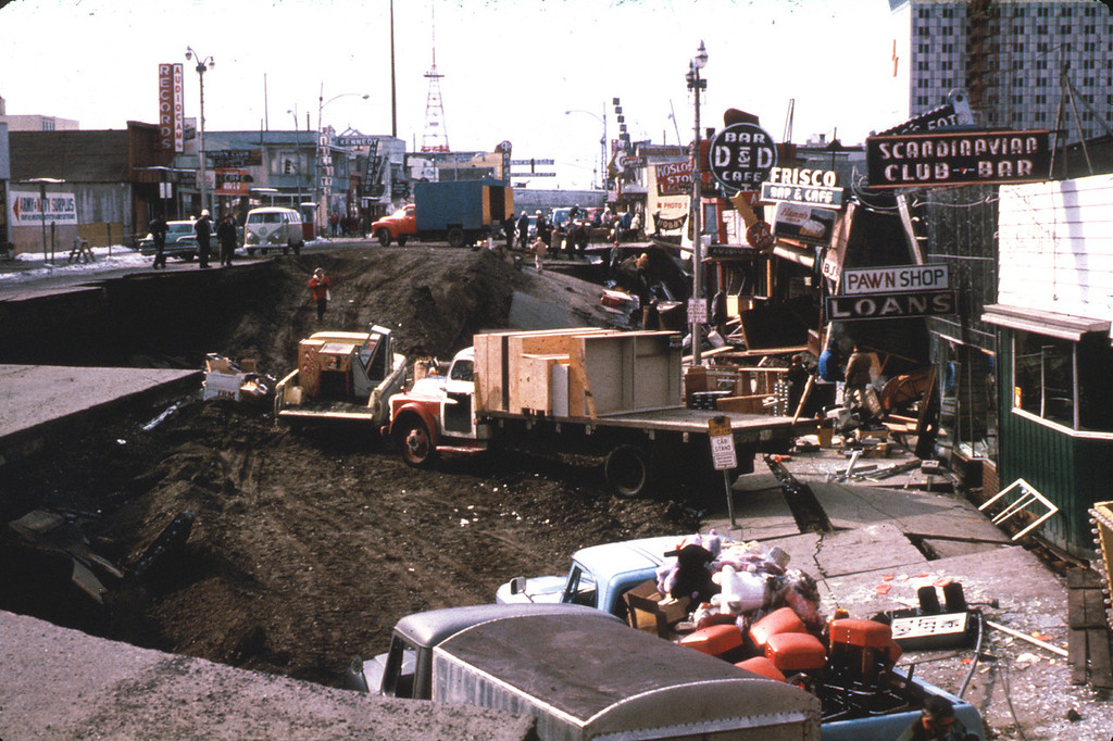 . In this March 1964 photo released by the U.S. Geological Survey, Anchorage small business owners clear salvageable items and equipment from their earthquake-ravaged stores on shattered Fourth Avenue in Alaska in the aftermath of an earthquake. (AP Photo/U.S. Geological Survey)