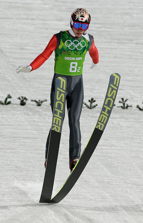 . Japan\'s Taku Takeuchi lands his trial jump during the ski jumping large hill team competition at the 2014 Winter Olympics, Monday, Feb. 17, 2014, in Krasnaya Polyana, Russia. (AP Photo/Matthias Schrader)