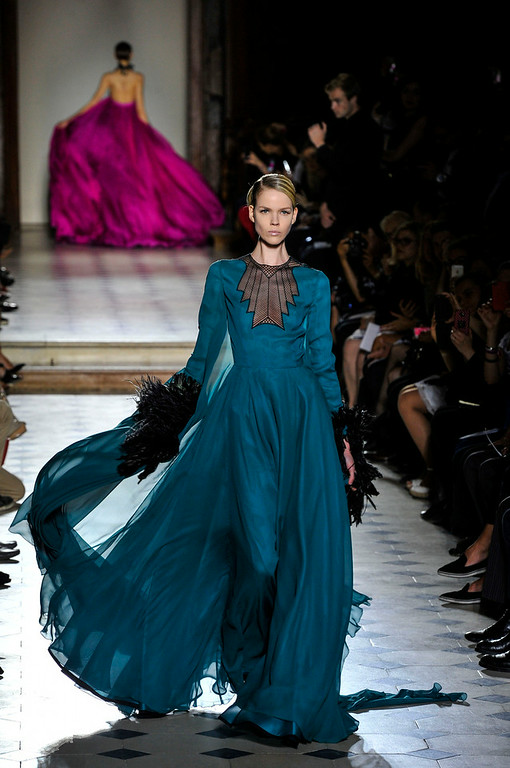. A model wears a creation by French fashion designer Julien Fournie, as part of his Fall Winter 2014-15 Haute Couture collection, presented in Paris, Tuesday, July 8, 2014. (AP Photo/ Zacharie Scheurer)