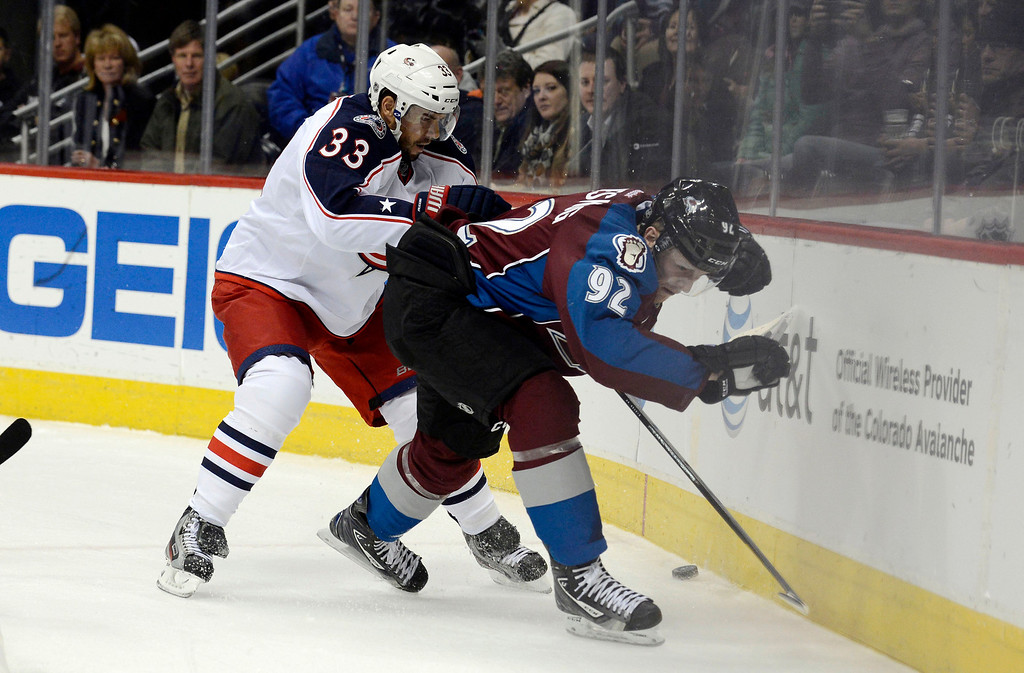 . DENVER, CO. - JANUARY 24: Columbus Blue Jackets defenseman Adrian Aucoin (33) battles with Colorado Avalanche left wing Gabriel Landeskog (92) along the boards for the puck during the first period at Pepsi Center. The Colorado Avalanche take on the Columbus Blue Jackets in NHL action.  (Photo By John Leyba / The Denver Post)