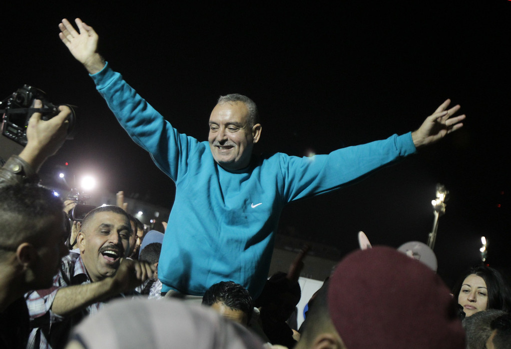 . A released Palestinian prisoner reacts upon his arrival at his headquarters in the West Bank city of Ramallah on October 30, 2013. Israel freed 26 Palestinian prisoners on Wednesday, the second stage of a limited amnesty designed to help US-sponsored peace talks.   ABBAS MOMANI/AFP/Getty Images