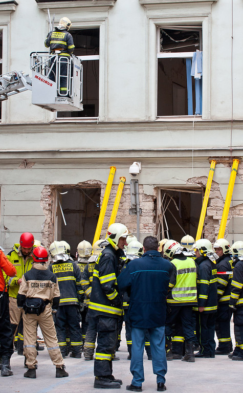 . Firemen and experts investigate the building damaged in a gas blast by on April 29, 2013 in Prague, Czech Republic. 35 people including foreigners were injured in the blast in a multistory house in the historic centre of Prague and causing panic in the Czech capital.  STRINGER/AFP/Getty Images