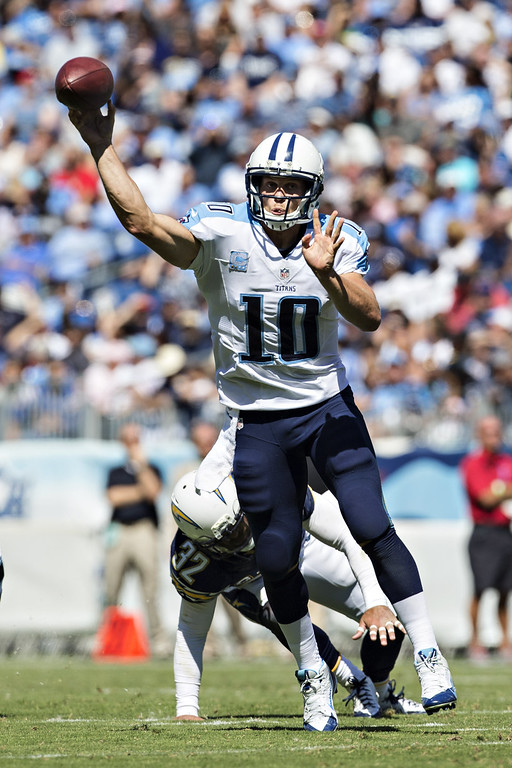 . Jake Locker #10 of the Tennessee Titans throws a pass against the San Diego Chargers at LP Field on September 22, 2013 in Nashville, Tennessee.  The Titans defeated the Chargers 20-17.  (Photo by Wesley Hitt/Getty Images)