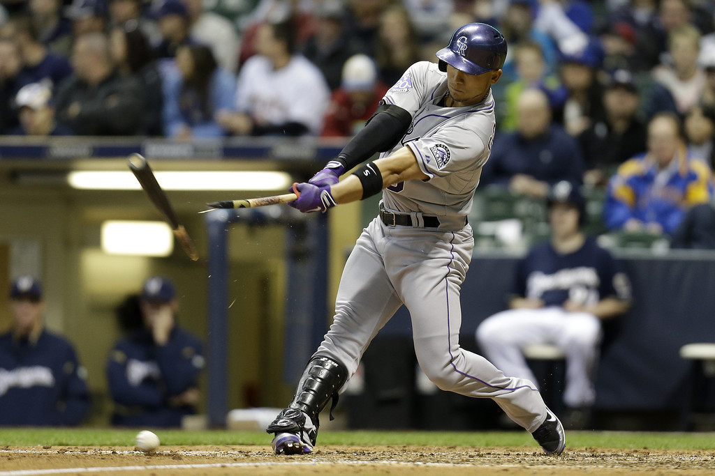. MILWAUKEE, WI - APRIL 2: Carlos Gonzalez #5 of the Colorado Rockies hits a broken bat single in the top of the 7th inning against the Milwaukee Brewers at Miller Park on April 2, 2013 in Milwaukee, Wisconsin. (Photo by Mike McGinnis/Getty Images)