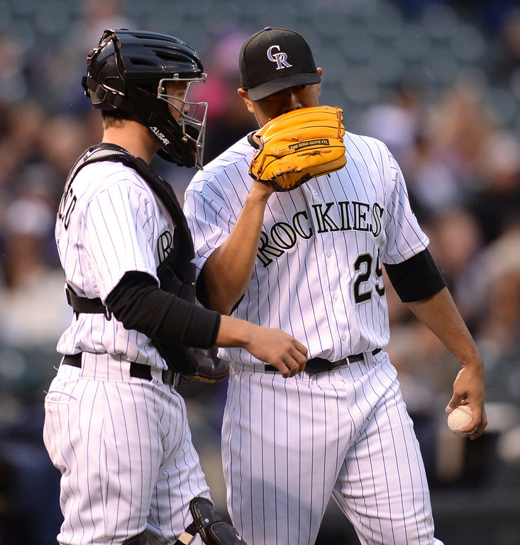 . DENVER, CO - APRIL 5:  Jorge De La Rosa talked things over with catcher Jordan Pacheco in the first inning. The Colorado Rockies hosted the Arizona Diamondbacks Saturday night, April 5, 2014 in Denver. (Photo by Karl Gehring/The Denver Post)