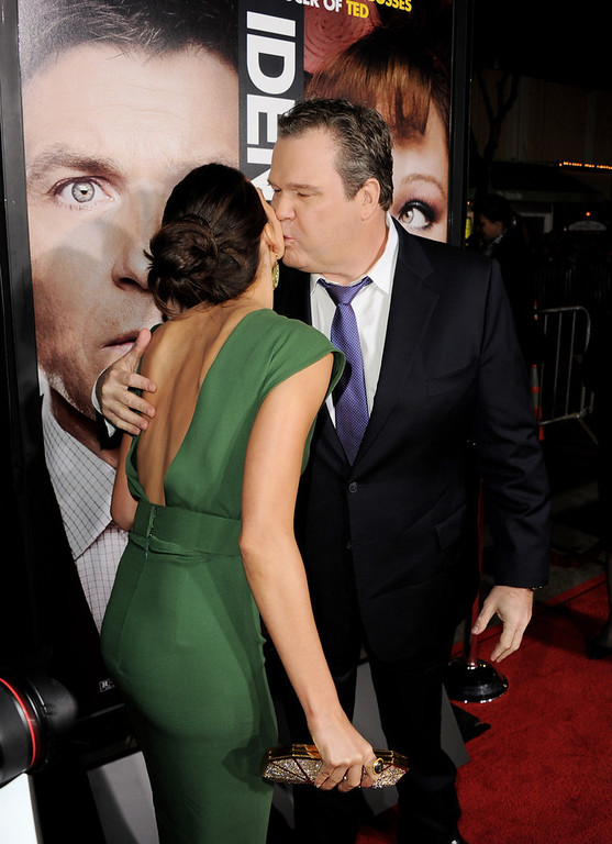 """. Actress Genesis Rodriguez (L) and actor Eric Stonestreet arrive at the premiere of Universal Pictures\' \""""Identity Theft\"""" at the Village Theatre on February 4, 2013 in Los Angeles, California.  (Photo by Kevin Winter/Getty Images)"""