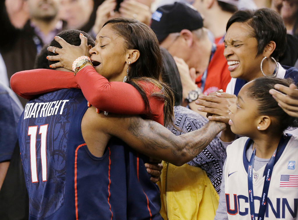 . Connecticut guard Ryan Boatright (11) gets a hug after his team beat Florida 63-53 at their NCAA Final Four tournament college basketball semifinal game Saturday, April 5, 2014, in Arlington, Texas. (AP Photo/Eric Gay)