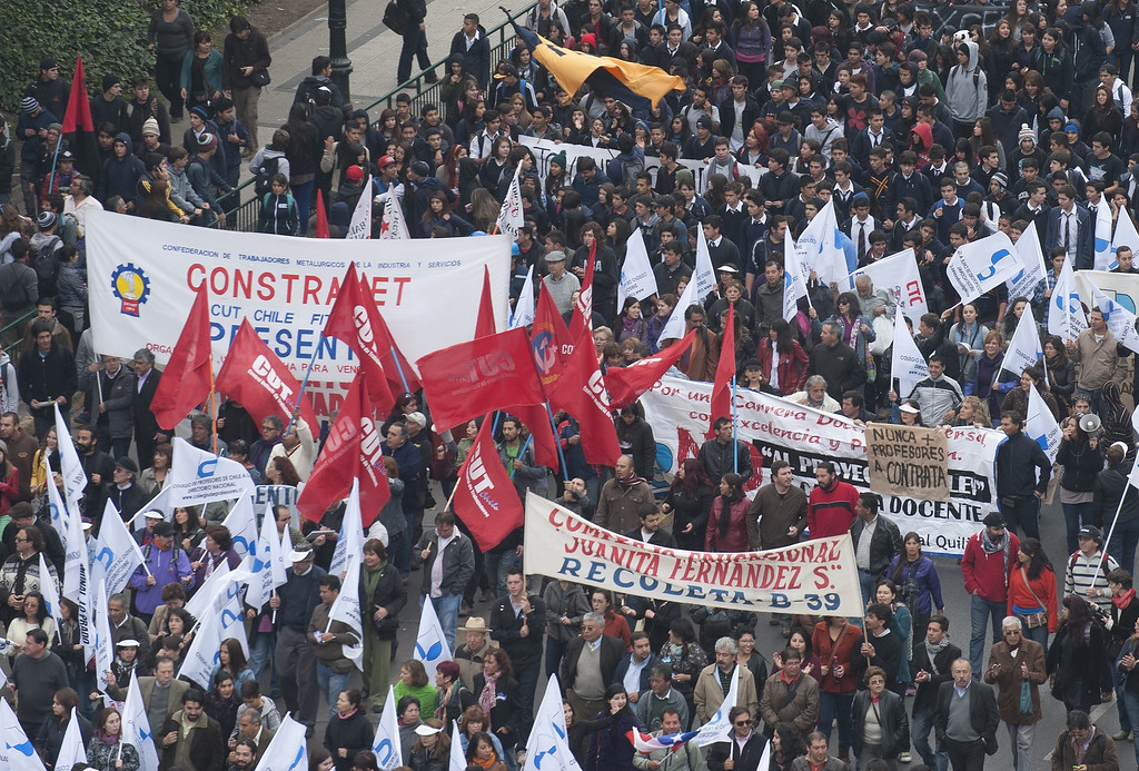 . Students march during a protest to demand Chilean President Sebastian Pinera\'s government to improve the public education quality, in Santiago, on April 11,2013. CLAUDIO SANTANA/AFP/Getty Images