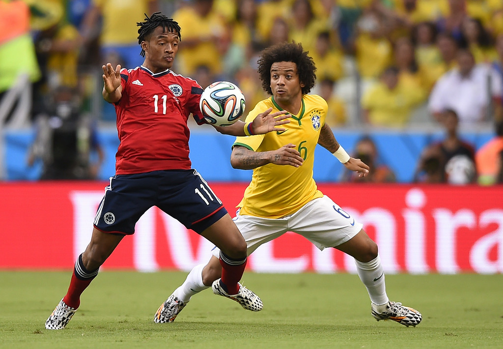 . Brazil\'s defender Marcelo (R) vies with Colombia\'s midfielder Juan Guillermo Cuadrado during the quarter-final football match between Brazil and Colombia at the Castelao Stadium in Fortaleza during the 2014 FIFA World Cup on July 4, 2014. FABRICE COFFRINI/AFP/Getty Images