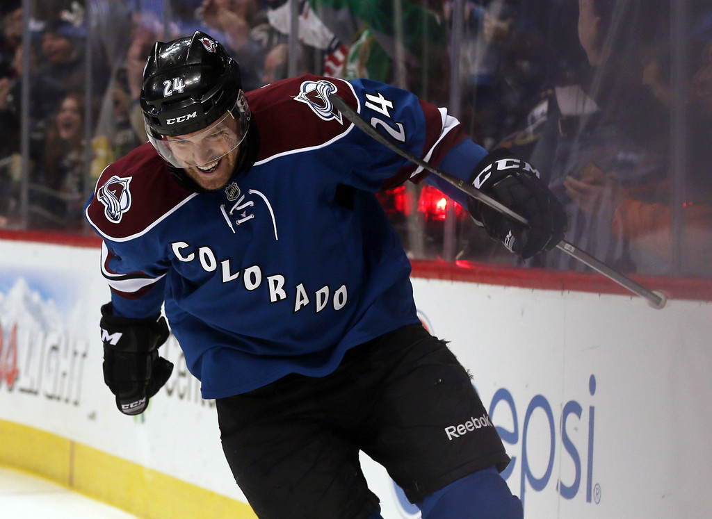 . Colorado Avalanche center Marc-Andre Cliche celebrates after scoring his first goal in the NHL on a redirected shot against the Buffalo Sabres in the second period of an NHL hockey game in Denver, Saturday, Feb. 1, 2014. (AP Photo/David Zalubowski)