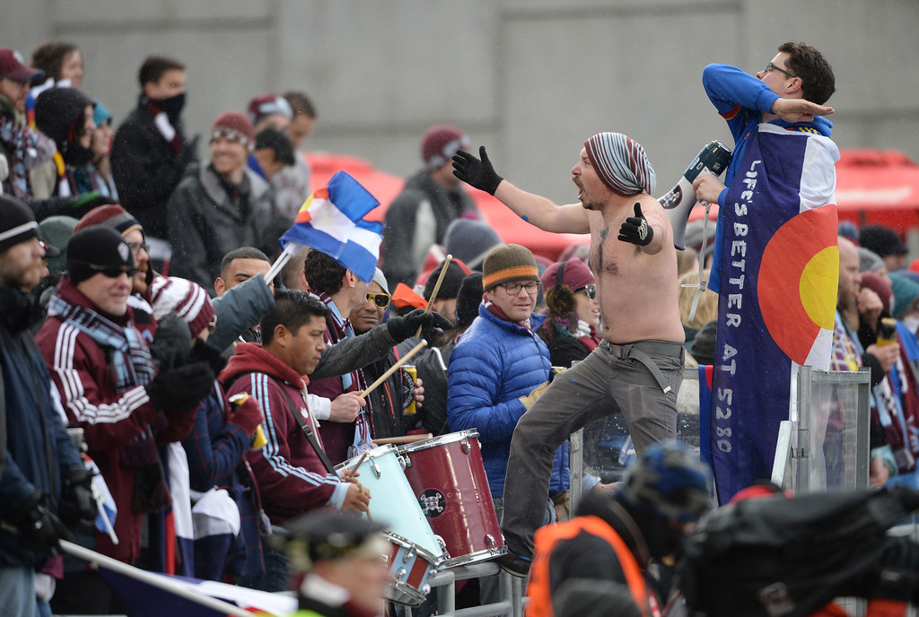 . COMMERCE CITY MARCH 22: Colorado Rapids fans cheer on the team during the 1st half of the game against Portland Timbers at Dick\'s Sporting Goods Park. Commerce City, Colorado. March 22. 2014. Colorado won 2-0.(Photo by Hyoung Chang/The Denver Post)